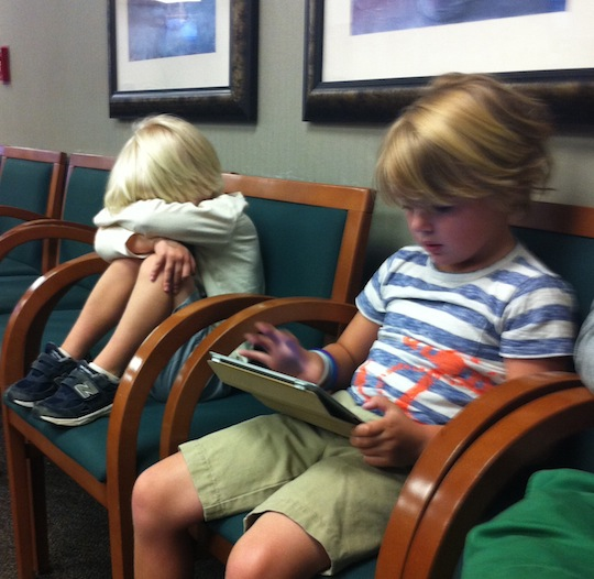 In the waiting room at 6 a.m.  Graham was more worried than Wells.  Or maybe he was sleepy.  Or maybe he just wanted the iPad.